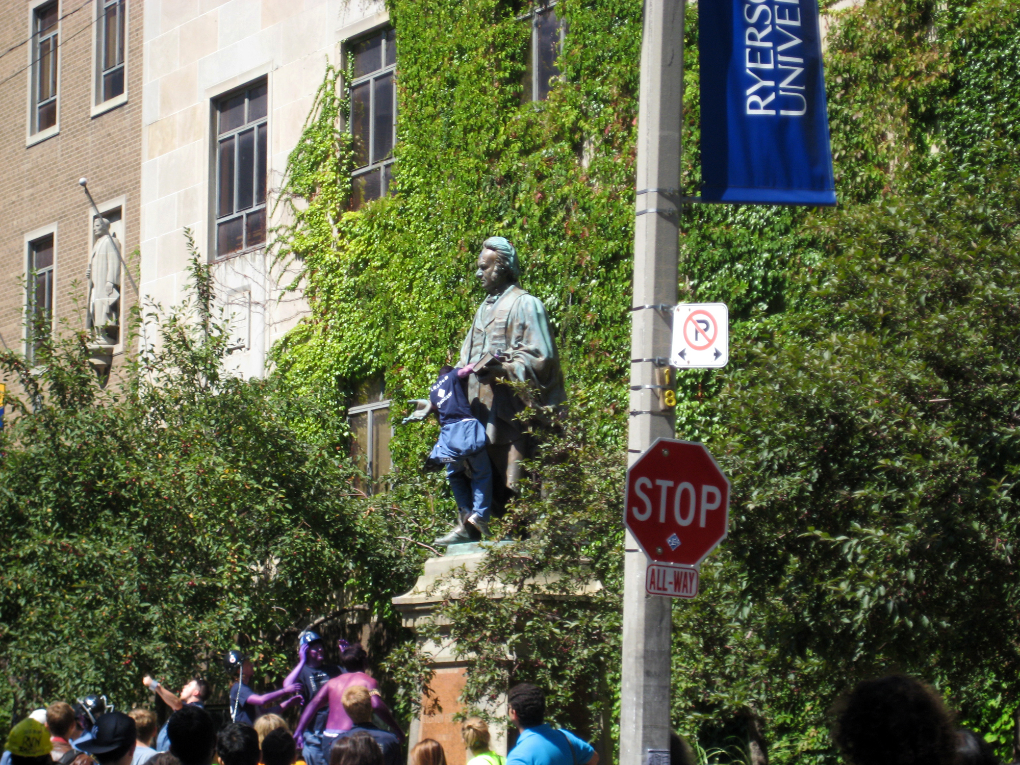 Students climbed the Egerton Ryerson statue in Toronto on Aug. 26, 2008. (Steve Silva)