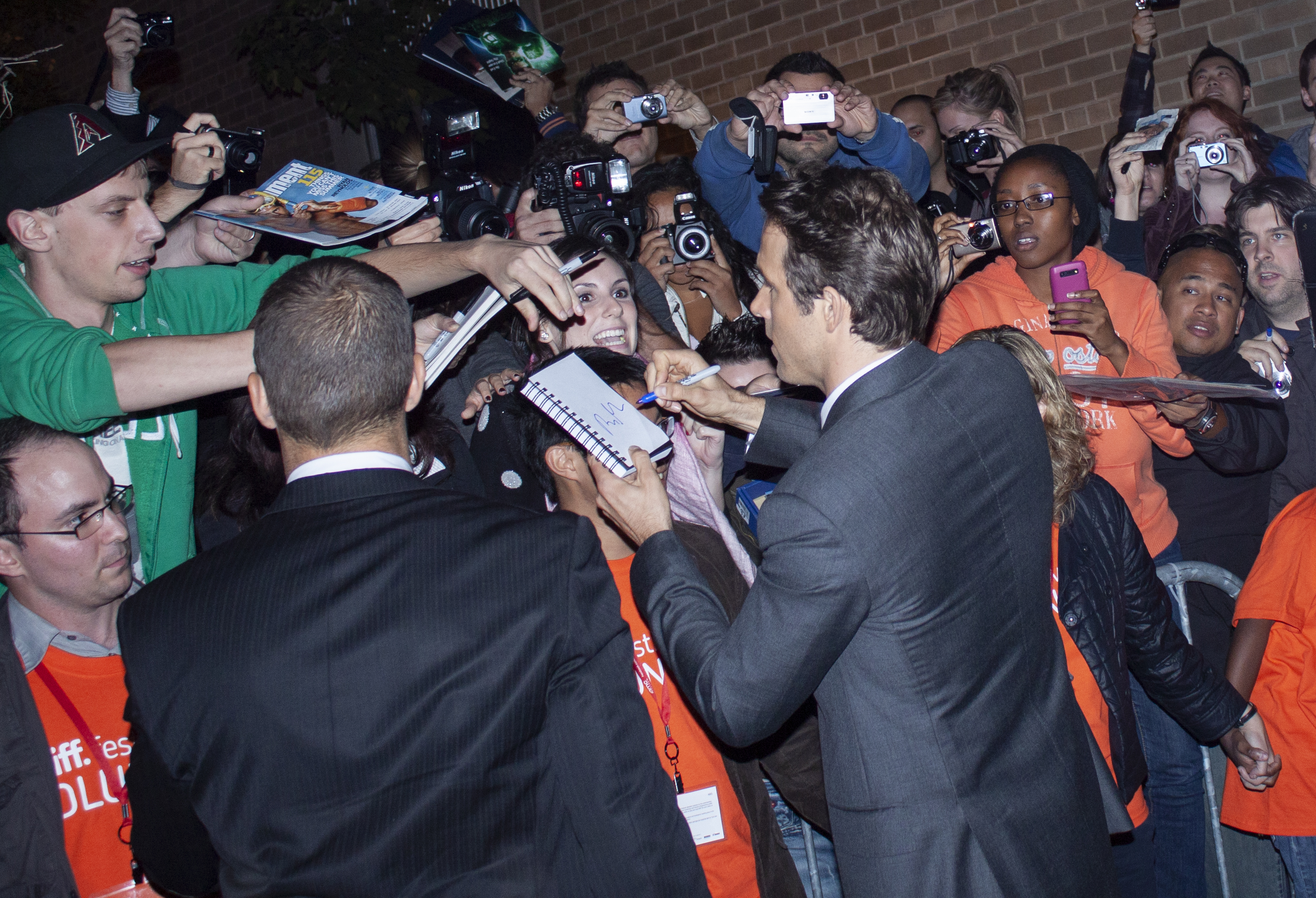 Ryan Reynolds signs autographs outside of Ryerson Theatre in Toronto during the Toronto International Film Festival on Sept. 14, 2010. (Steve Silva)