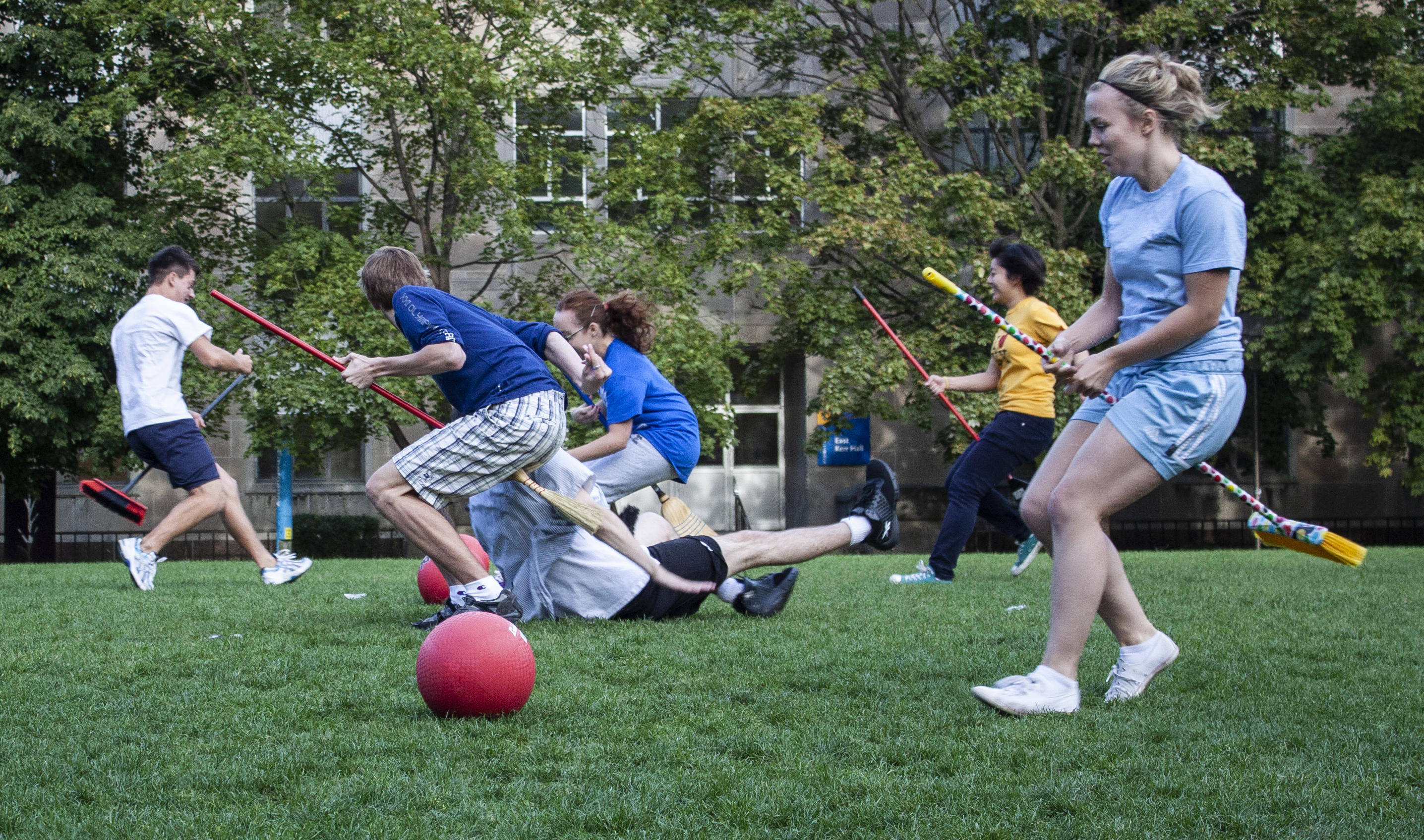"Ryerson University students play a round of Quidditch, inspired by the ""Harry Potter"" series, in Toronto on Sept. 19, 2010. (Steve Silva)"